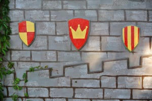 red-yellow shields background a brick wall